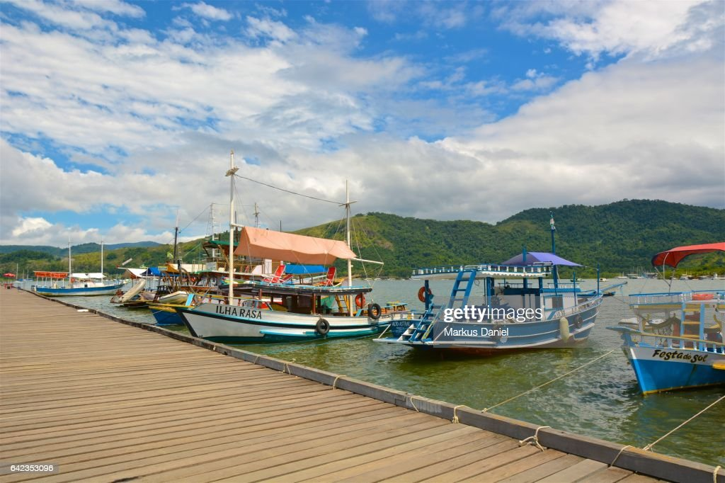 Day trip boats at the main pier in the town of Paraty, Rio de Janeiro : Stock Photo