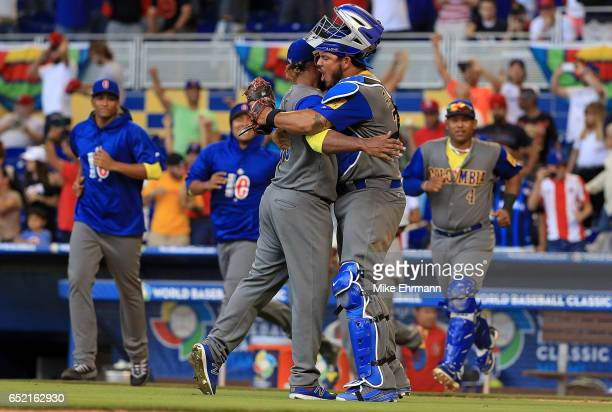 Dayan Diaz and Jhonatan Solano of Colombia celebrate winning a Pool C game of the 2017 World Baseball Classic against Canada at Miami Marlins Stadium...