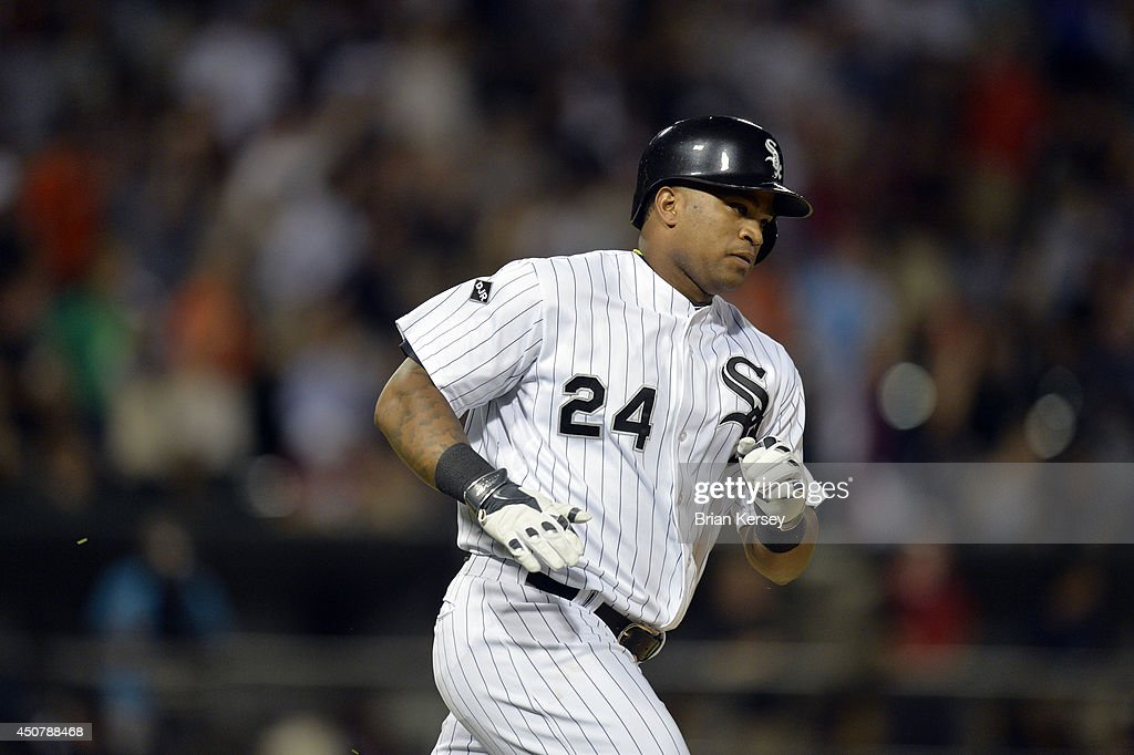 Dayan Viciedo #24 of the Chicago White Sox runs up the first base line after hitting a two-run home run scoring Adam Dunn during the fifth inning against the San Francisco Giants at U.S. Cellular Field on June 17, 2014 in Chicago, Illinois.