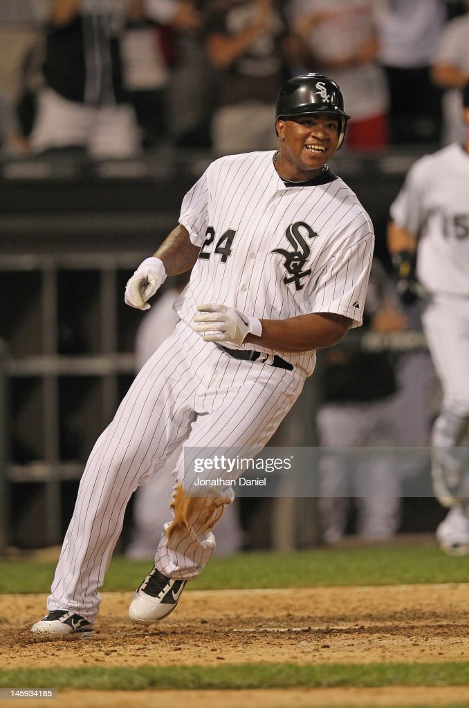 Dayan Viciedo #24 of the Chicago White Sox smiles as he crosses the plate with the winning run in the bottom of the 9th inning against the Toronto Blue Jays at U.S. Cellular Field on June 7, 2012 in Chicago, Illinois. The White Sox defeated the Blue Jays 4-3.
