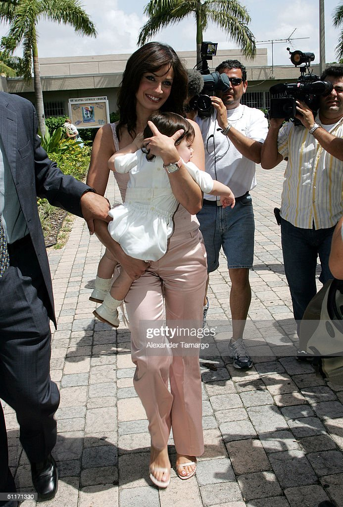 Dayanara Torres holds baby Ryan as she arrives for Ryan's baptism ceremony at Saint Agatha's Church on August 14, 2004 in Miami, Florida.