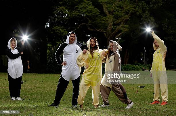 Dayanna Grageda Miss Earth Australia and other animal lovers pose in animal onesies after participating in a Yoga class at Hyde Park on June 7 2016...