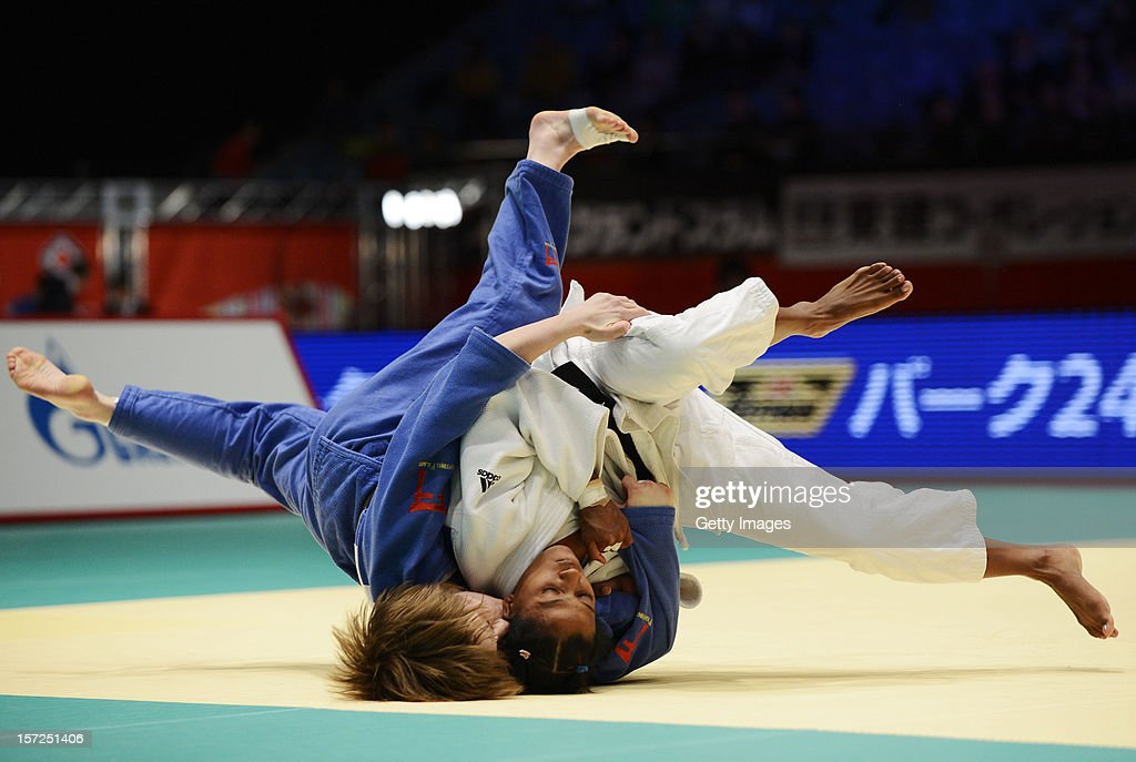 Dayaris Mestre Alvarez (R) of Cuba and ROSSENEU, Amelie Rosseneu (L) of Belgium compete in the Women's 48kg semi-final during day one of the Judo Grand Slamat Yoyogi Gymnasium on November 30, 2012 in Tokyo, Japan.
