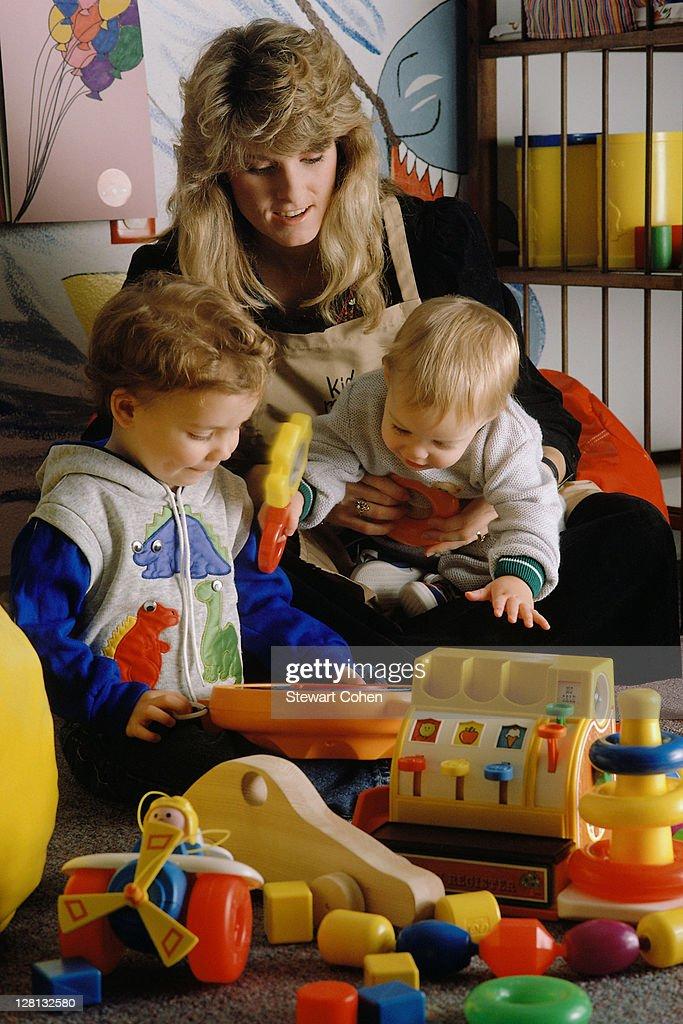 CHIPL051 Daycare teacher w/children : Stock Photo