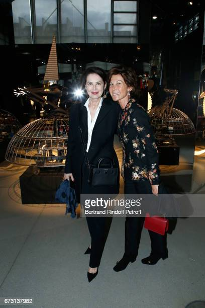 Dayle Haddon and Sylvie Rousseau pose in front the works of JeanPaul Goude during the 'Societe des Amis du Musee d'Art Moderne du Centre Pompidou'...