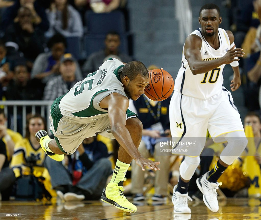 Daylen Harrison #35 of the Eastern Michigan Eagles tries to stay on his feet next tho Tim Hardaway Jr. #10 of the Michigan Wolverines at Crisler Center on December 20, 2012 in Ann Arbor, Michigan.