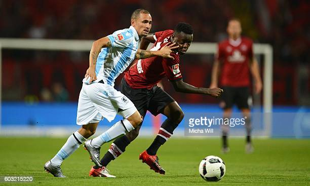 Daylon Claasen of Muenchen and Edgar Salli of Nuernberg compete for the ball during the Second Bundesliga match between 1 FC Nuernberg and TSV 1860...