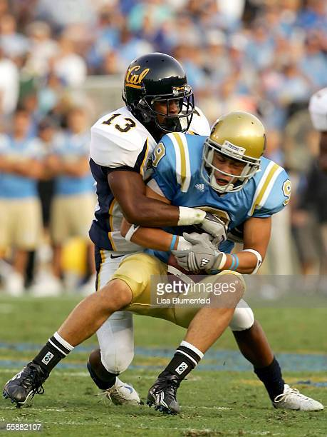 Daymeion Hughes of the University of California Golden Bears tackles Marcus Everett of the UCLA Bruins October 8 2005 at the Rose Bowl in Pasadena...