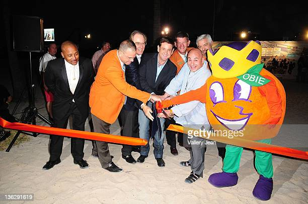 Daymond John Eric Poms Jerry Libbin Michael Gongora Luis E Boue Jeffery T Roberts and Gary Cioffi attend the Ribbon Cutting Ceremony at The Orange...