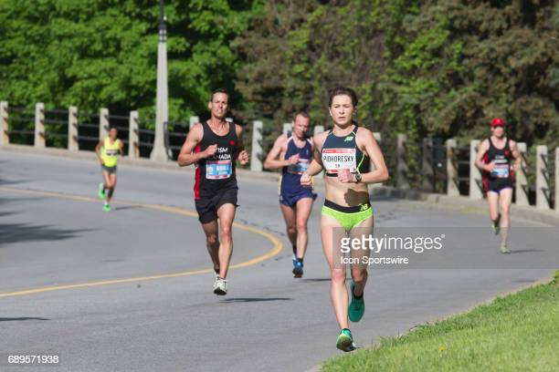 Dayna Pidhoresky running to finish top Canadian in the Ottawa Marathon road race during the Tamarack Ottawa Race Weekend The Ottawa Marathon is part...