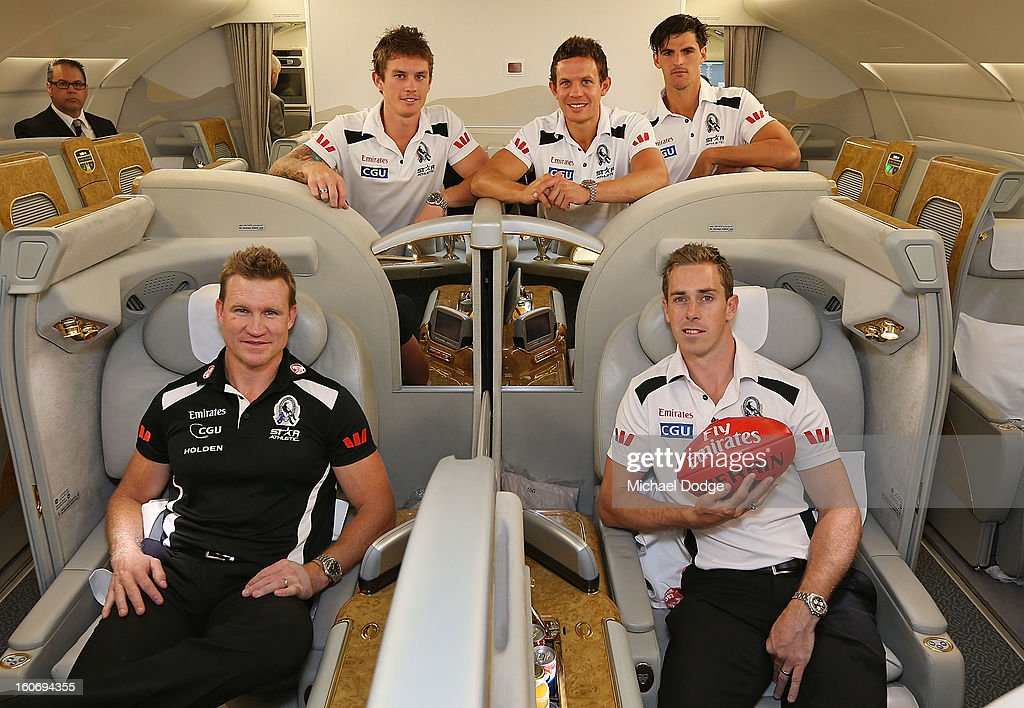 Dayne Beams, <a gi-track='captionPersonalityLinkClicked' href=/galleries/search?phrase=Luke+Ball&family=editorial&specificpeople=208157 ng-click='$event.stopPropagation()'>Luke Ball</a> and Scott Pendlebury stand behind coach <a gi-track='captionPersonalityLinkClicked' href=/galleries/search?phrase=Nathan+Buckley&family=editorial&specificpeople=176545 ng-click='$event.stopPropagation()'>Nathan Buckley</a> and captain <a gi-track='captionPersonalityLinkClicked' href=/galleries/search?phrase=Nick+Maxwell&family=editorial&specificpeople=596853 ng-click='$event.stopPropagation()'>Nick Maxwell</a> in the cabin of an Emirates A380 aircraft after the Collingwood Magpies 2013 Captaincy And Leadership Group Announcement at Melbourne Airport on February 5, 2013 in Melbourne, Australia.