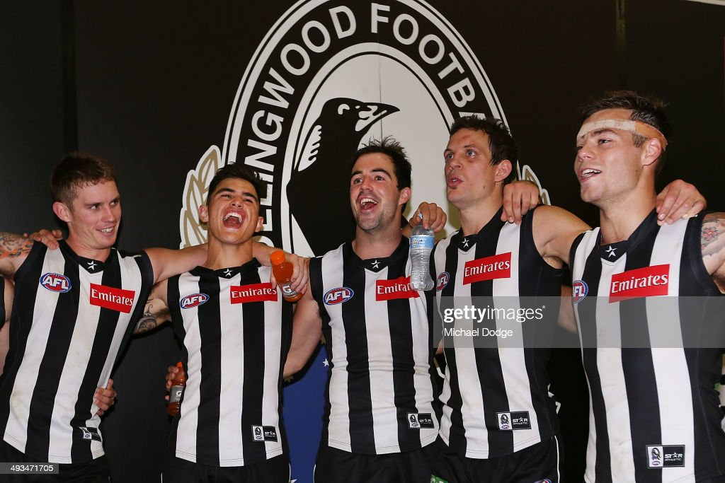 Dayne Beams, Marley Williams, Steele Sidebottom, Luke Ball and Jamie Elliott of the Magpies sing the song after winning the round 10 AFL match between the Collingwood Magpies and West Coast Eagles at Melbourne Cricket Ground on May 24, 2014 in Melbourne, Australia.
