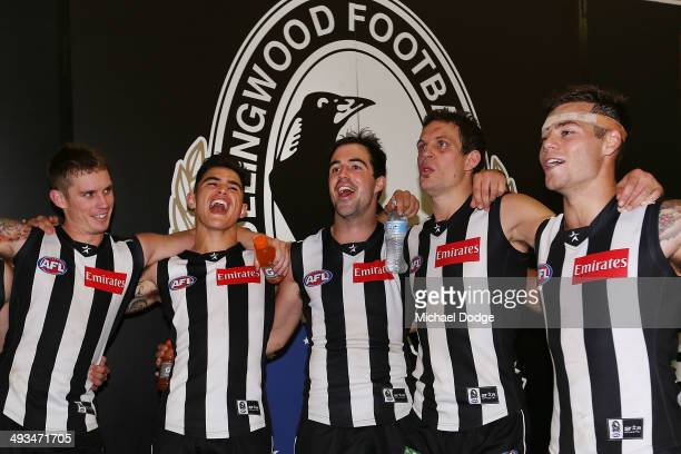 Dayne Beams Marley Williams Steele Sidebottom Luke Ball and Jamie Elliott of the Magpies sing the song after winning the round 10 AFL match between...