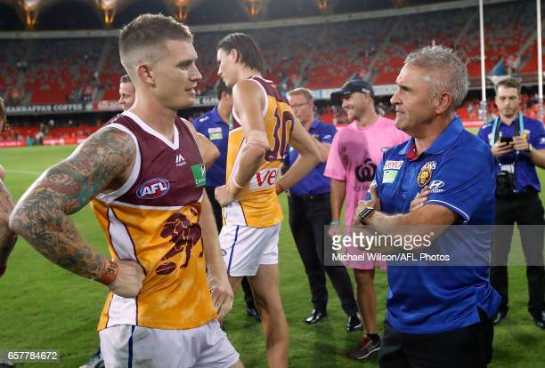 Dayne Beams of the Lions and Chris Fagan Senior Coach of the Lions celebrate during the 2017 AFL round 01 match between the Gold Coast Suns and the...