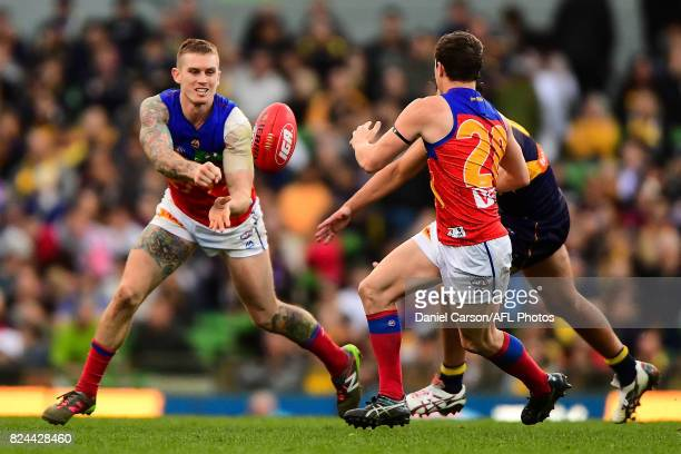Dayne Beams of the Lions handpasses the ball during the 2017 AFL round 19 match between the West Coast Eagles and the Brisbane Lions at Domain...