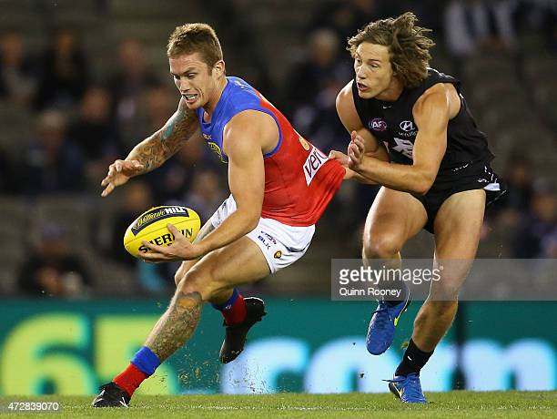 Dayne Beams of the Lions is tackled by Mark Whiley of the Blues during the round six AFL match between the Carlton Blues and the Brisbane Lions at...
