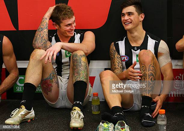 Dayne Beams of the Magpies celebrates the win with Marley Williams during the round 12 AFL match between the Melbourne Demons and the Collingwood...