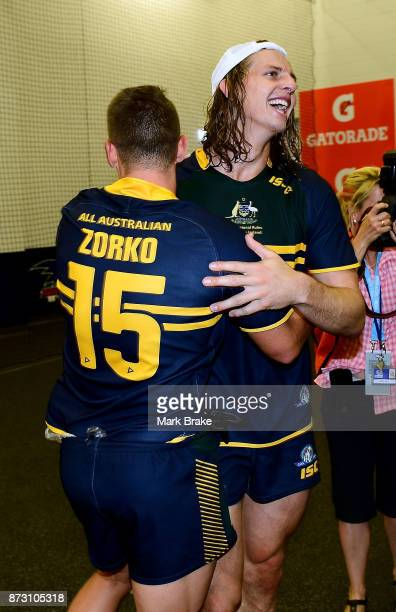 Dayne Zorko and Nat Fyfe of Australia celebrate in the rooms after game one of the International Rules Series between Australia and Ireland at...