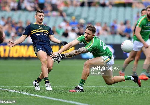 Dayne Zorko of Australia kicks past Zach Tuohy of Ireland during game one of the International Rules Series between Australia and Ireland at Adelaide...