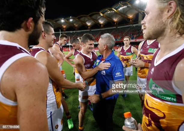 Dayne Zorko of the Lions and Chris Fagan Senior Coach of the Lions celebrate during the 2017 AFL round 01 match between the Gold Coast Suns and the...