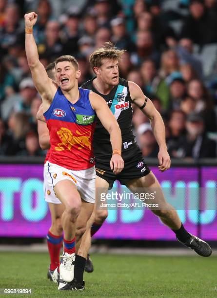 Dayne Zorko of the Lions celebrates a goal during the 2017 AFL round 13 match between Port Adelaide Power and the Brisbane Lions at the Adelaide Oval...