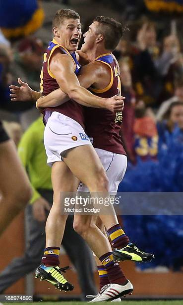 Dayne Zorko of the Lions celebrates his goal with Tom Rockliff during the round eight AFL match between the Essendon Bombers and the Brisbane Lions...