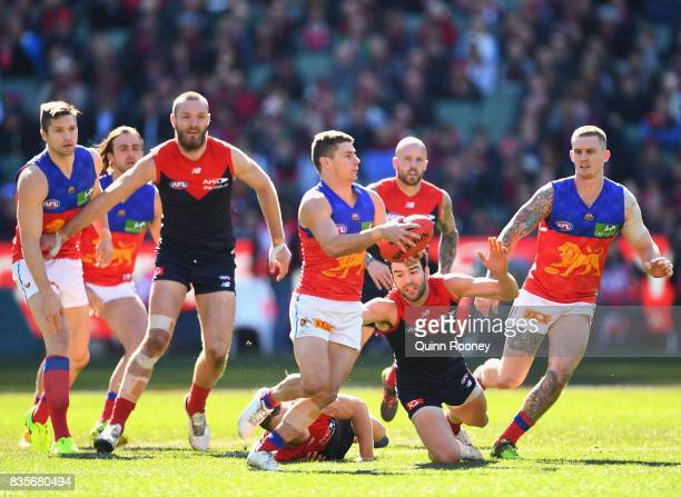 Dayne Zorko of the Lions clears the ball from the centre during the round 22 AFL match between the Melbourne Demons and the Brisbane Lions at...
