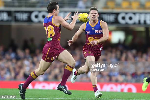 Dayne Zorko of the Lions handballs during the round 18 AFL match between the Brisbane Lions and the Carlton Blues at The Gabba on July 23 2017 in...