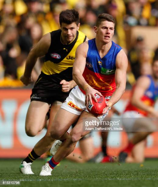 Dayne Zorko of the Lions in action ahead of Trent Cotchin of the Tigers during the 2017 AFL round 17 match between the Richmond Tigers and the...
