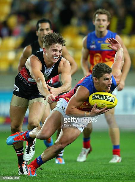 Dayne Zorko of the Lions is tackled by Jack Billings of the Saints during the round six AFL match between the St Kilda Saints and the Brisbane Lions...