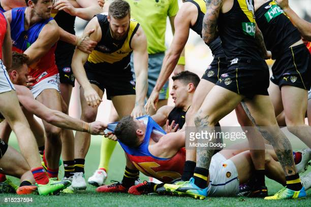 Dayne Zorko of the Lions is wrestled to the ground during the round 17 AFL match between the Richmond Tigers and the Brisbane Lions at Etihad Stadium...