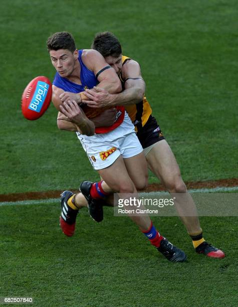 Dayne Zorko of the Lions looks to get his handball away during the round eight AFL match between the Hawthorn Hawks and the Brisbane Lions at...