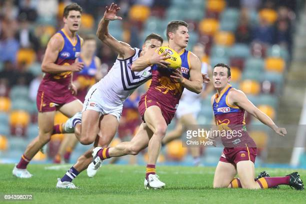 Dayne Zorko of the Lions runs the ball during the round 12 AFL match between the Brisbane Lions and the Fremantle Dockers at The Gabba on June 10...
