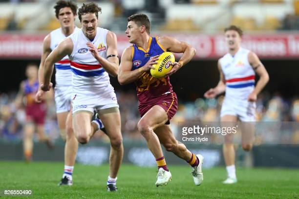 Dayne Zorko of the Lions runs the ball during the round 20 AFL match between the Brisbane Lions and the Western Bulldogs at The Gabba on August 5...