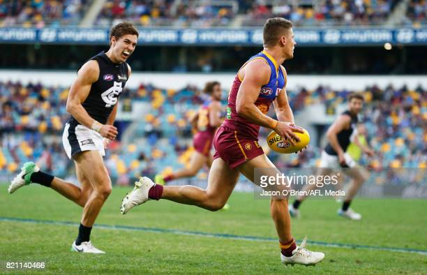 Dayne Zorko of the Lions runs with the ball during the round 18 AFL match between the Brisbane Lions and the Carlton Blues at The Gabba on July 23...