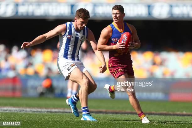 Dayne Zorko of the Lions takes a mark during the round 23 AFL match between the Brisbane Lions and the North Melbourne Kangaroos at The Gabba on...