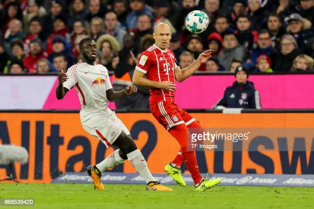 Dayot Upamecano of Leipzig and Arjen Robben of Muenchen battle for the ball during the Bundesliga match between FC Bayern Muenchen and RB Leipzig at...