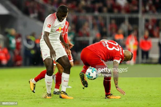 Dayot Upamecano of Leipzig and Arturo Erasmo Vidal of Muenchen battle for the ball during the Bundesliga match between FC Bayern Muenchen and RB...