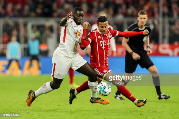 Dayot Upamecano of Leipzig and Thiago Alcantara of Muenchen battle for the ball during the Bundesliga match between FC Bayern Muenchen and RB Leipzig...