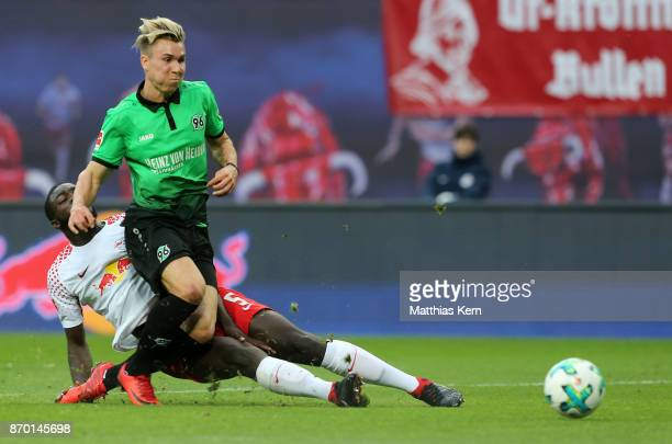 Dayot Upamecano of Leipzig battles for the ball with Felix Klaus of Hannover during the Bundesliga match between RB Leipzig and Hannover 96 at Red...