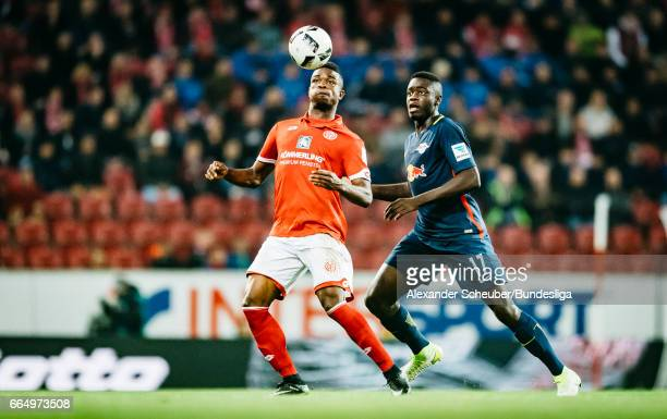 Dayot Upamecano of Leipzig challenges Jhon Cordoba of Mainz 05 during the Bundesliga match between 1 FSV Mainz 05 and RB Leipzig at Opel Arena on...