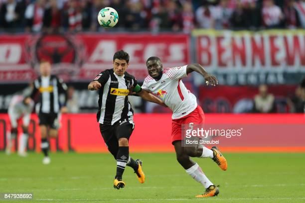 Dayot Upamecano of Leipzig fights for the ball with Jonas Hofmann of Moenchengladbach during the Bundesliga match between RB Leipzig and Borussia...