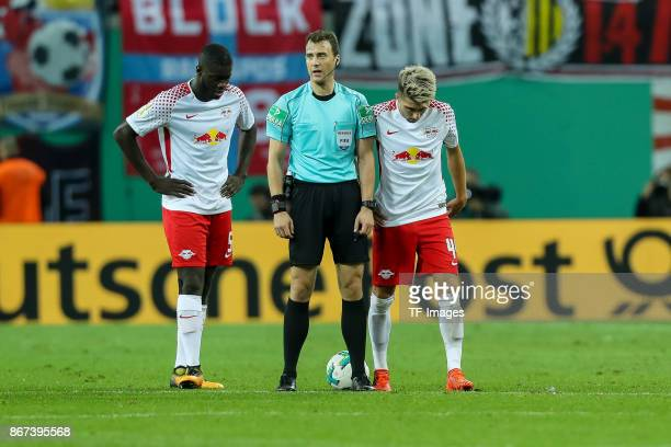 Dayot Upamecano of Leipzig referee Felix Zwayer and Kevin Kampl of Leipzig look on during the DFB Cup round 2 match between RB Leipzig and Bayern...