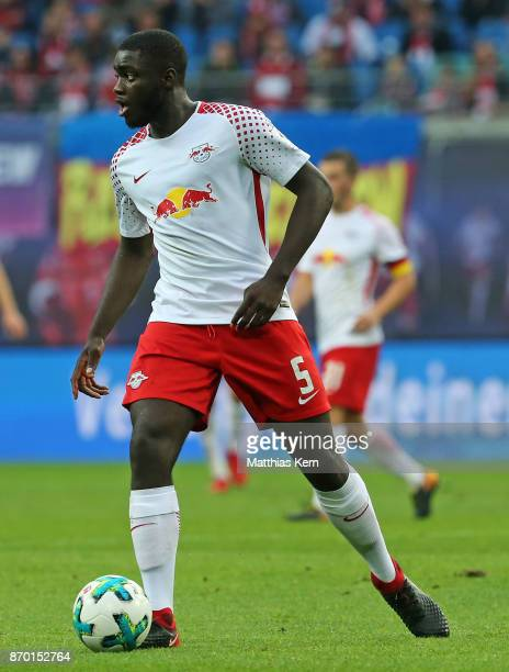 Dayot Upamecano of Leipzig runs with the ball during the Bundesliga match between RB Leipzig and Hannover 96 at Red Bull Arena on November 4 2017 in...