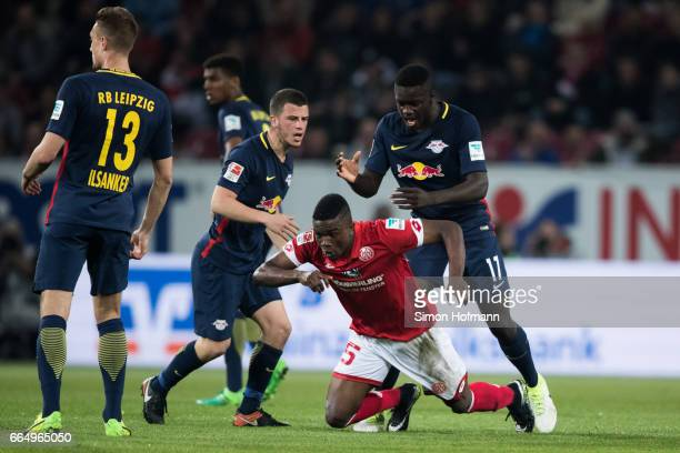 Dayot Upamecano of Leipzig tackles Jhon Cordoba of Mainz during the Bundesliga match between 1 FSV Mainz 05 and RB Leipzig at Opel Arena on April 5...