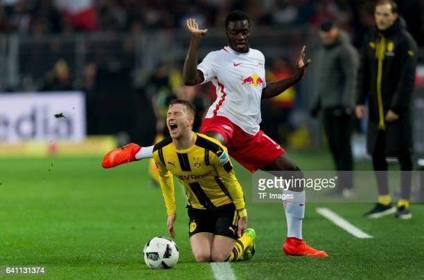 Dayot Upamecano of RB Leipzig and Marco Reus of Borussia Dortmund battle for the ball during the Bundesliga soccer match between Borussia Dortmund...