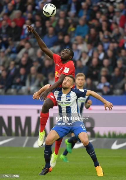 Dayot Upamecano of RB Leipzig and Vedad Ibisevic of Hertha BSC during the game between Hertha BSC and RB Leipzig on may 6 2017 in Berlin Germany