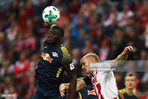 Dayot Upamecano of RB Leipzig battles for the ball with Frederik Sorensen of FC Koeln during the Bundesliga match between 1 FC Koeln and RB Leipzig...