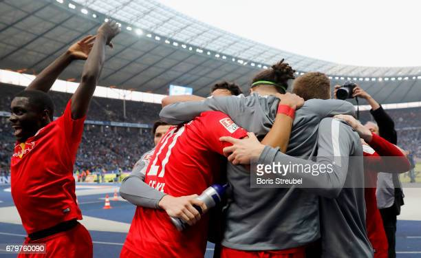 Dayot Upamecano of RB Leipzig celebrates with team mates after winning the Bundesliga match between Hertha BSC and RB Leipzig at Olympiastadion on...