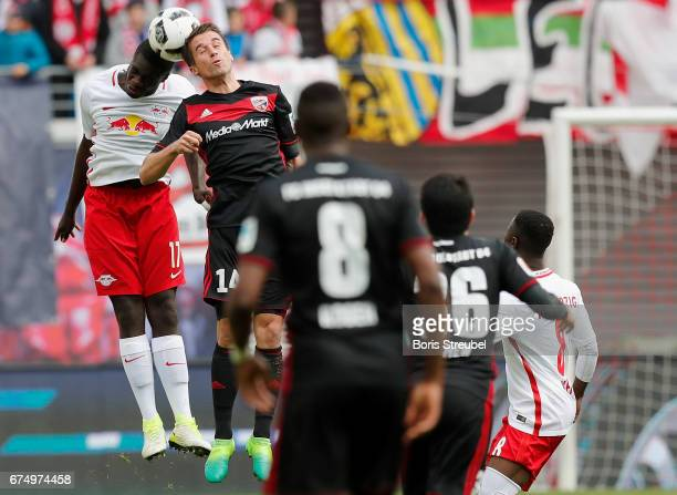Dayot Upamecano of RB Leipzig jumps for a header with Stefan Lex of FC Ingolstadt 04 during the Bundesliga match between RB Leipzig and FC Ingolstadt...